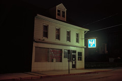 (patrickjoust) Tags: shenandoah pennsylvania schuylkillcounty maytagrepairman sign glow fujicagw690 kodakportra160 6x9 medium format 120 rangefinder c41 color negative film cable release tripod long exposure night after dark manual focus analog mechanical patrick joust patrickjoust central pa usa us united states north america estados unidos autaut small town coal country abandoned vacant empty store shop maytag repairman deli
