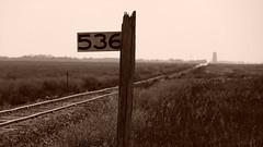 Battered Milepost on the Prairie (Electroburger) Tags: milepost 536 dmvw kramer nd