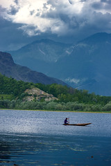 A storm approaches (Eye.Ess.Ohh) Tags: travel blue sunset summer sky india lake storm color water girl beautiful clouds dark boat paradise kashmir srinagar