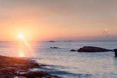 Sunrise, Northeast Coast, Taiwan (Eddy Tsai) Tags: ocean morning sunset sea summer mountain man reflection beach nature colors clouds sunrise landscape island dawn bay coast boat fishing scenery village  famous taiwan galaxy fisher  tradition ht  eddy
