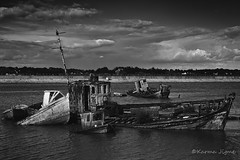 Boat Cemetery (karmajigme) Tags: travel sea blackandwhite water monochrome cemetery clouds landscape boats nikon noiretblanc