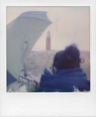 To the lighthouse (ale2000) Tags: polaroid impossible instant sx70 600 600color texel nederlands holland olanda noordzee vuurtoren lighthouse faro northernsea maredelnord umbrella ombrello frombehind dispalle