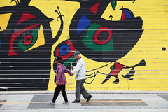 Magical realism (Elios.k) Tags: horizontal outdoors people two man woman old blindman blind white cane walk walking step help guide guiding holdingbythehand tuggingsleeve kindness helping kind korean stairs painted painting joanmiro joanmiró colorful decoration yellow lelezardauxplumesdor thelizardwithgoldenfeathers sejongcenter exhibition art travel travelling august 2016 summer vacation canon 5dmkii camera photography colour color gwanghwamun plaza square jongno seoul korea southkorea asia
