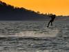 Waterdance (bikeracer) Tags: sunset silhouette 510fav flying saveme4 wake deleteme10 air flight nj wave kiteboarding spray caught takeoff sandyhook title2 parasurfing title3 interestingness94 i500 title1 explore22feb06