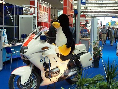 Tux on a police bike