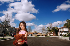 A girl and her bear (fd) Tags: bear family portrait sky childhood clouds daughter 1870mmf3545g suburbs lightproofboxcom utatafeature