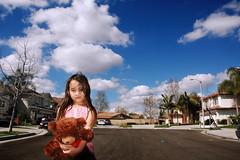 A girl and her bear (fd) Tags: bear family portrait sky childhood clouds daughter 1870mmf3545g suburbs lightproofboxcom utatafeature