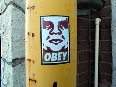 Friends in low places (GeorgeCurious) Tags: streetart giant graffiti sticker stickerart obey shepardfairey