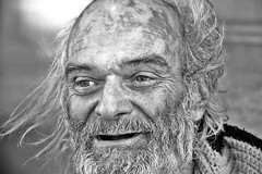 candle in the wind (stoneth) Tags: poverty sf sanfrancisco california ca street portrait people blackandwhite bw 15fav white man black male eye topf25 face topv111 closeup 1025fav 510fav hair blackwhite eyes topv555 topv333 nikon day d70 nikond70 homeless poor photojournalism forsakenpeople social impoverished 2006 100v10f 1870mmf3545g human 2550fav grayscale nikkor 110fav streetshot 125fav sfcivic
