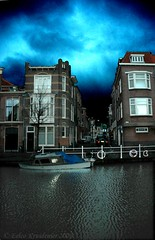 They say spring will soon be here (smiling_da_vinci) Tags: houses light clouds dark canal leiden alley moody 10 eerie boast