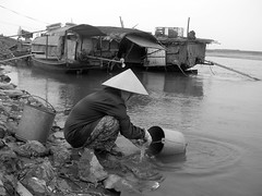 its the hard knock life! (Zenith Phuong) Tags: life people bw topf25 tag3 taggedout river topv333 women tag2 tag1 vietnam hanoi 75points mireasrealm zenithphuong twtmesh35075