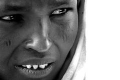 sharpened teeth woman (adritzz) Tags: africa travel portrait bw 500v20f desert saveme2 deleteme10 tribal aid nomad ethnic 87points mireasrealm diversidadcultural top20travelportraits