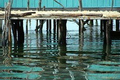 aninag (Farl) Tags: wood travel sea house reflection green water colors yellow muslim philippines sulu stilts drying
