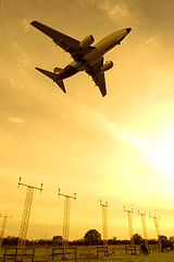 Commercial airplane landing (Greg Bajor) Tags: uk greatbritain travel sunset england sky holiday london yellow speed plane sunrise airplane lights for fly flying airport movement unitedkingdom britain heathrow aircraft aviation air united touch transport flight wing jet fast kingdom gear down off aeroplane landing business journey commercial transportation airline wharf commuter british local boeing concept airways airports gregory airlines takeoff runway flights atmospheric airliner lhr airliners aerospace digest 737 flaps birdlike egll wonderworld bajor worldbest aplusphoto birdlikeimages gregbajor