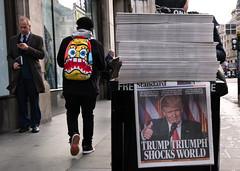 Trump Triumph (stevedexteruk) Tags: usa president election trump donald newspaper headline triumph oxfordcircus london uk city westminster standard eveningstandard news face rucksack 2016 regentstreet street people