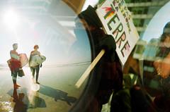 No destruir la Tierra (-Antoine-) Tags: california sun canada beach topf25 sign soleil lomo lca san surf montral sandiego quebec doubleexposure montreal surfer diego double fisheye demonstration exposition qubec flare surfers ck doubleexposition pancarte plage share collaboration manifestation destroy dtruire ant~ck surfeurs detruire destruir antoinerouleau