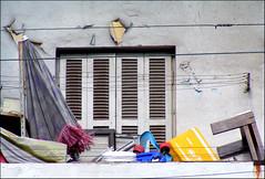 magic balcony (Tal Bright) Tags: urban white window yellow telaviv mess random balcony magic shutters salame balagan florentin