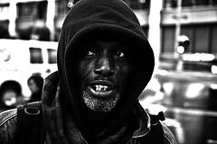 released (stoneth) Tags: poverty 2005 sf sanfrancisco california ca street portrait people urban blackandwhite bw 15fav white man black male eye face topv111 closeup 1025fav 510fav person blackwhite eyes nikon d70 nikond70 homeless poor photojournalism forsakenpeople social impoverished 1870mmf3545g human hood grayscale nikkor 110fav jawa destitute drifter streetshot 125fav 222v2f sfcivic