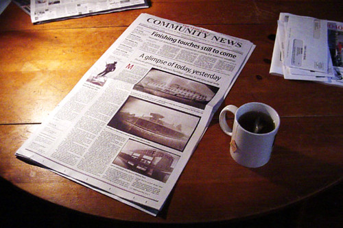 newspaper on table with mug of tea