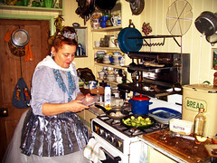 My Mother, cooking Christmas lunch (George Pollard) Tags: mother mum elke northampton fairy kitchen cooking christmaslunch christmasday courgettes fryingpan cooker teatowel butterdish breadbin