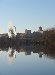 Downtown Lynchburg (Luke Sharrett) Tags: water river griffin pipe factory plant pipes manufacture manufacturing industry industrial skyline downtown city lynchburg tree trees skyscraper banks james bank smoke exhaust sky reflection mirrorimage mirror image reflections