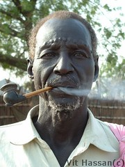 Smoking man from a Denka tribe (Vt Hassan) Tags: africa portrait people look topv111 image south sudan pipe smoking marks tribe reallife theface denka shluh malakal