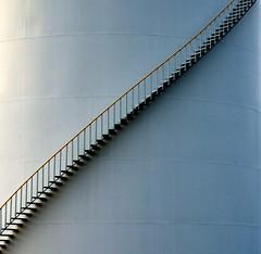 Single Tank Stairway (SCFiasco) Tags: stairs composition interestingness stair tank haiku deleteme10 topc75 interestingness1 minimal saveme10 topv5555 500v50f minimalism simple oneyear minimalistic topf250 haikus scfiasco 1000v40f siasoco n321fave world100f edwinsiasoco edsiasoco