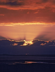 Hebridean Sunrise (ßlϋeωãvε) Tags: uk blue trees red sea sky orange cloud sun reflection tree green grass yellow clouds sunrise skyscape island scotland bright lewis rays sunrays isleoflewis hebrides stornoway outerhebrides hebridean