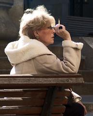 Hate smoking outdoors (Xos Castro) Tags: people lady bench outdoors exterior faces gente cigarette smoke banco streetlife smoking caracas personas sentado seated fumar cigarrillo seor
