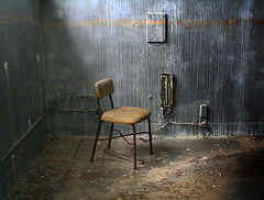 jail chair (wizmo) Tags: chair oldbuildings prison jail forsakenplaces fortord stockade abandonedplaces oldchair desertedmilitary