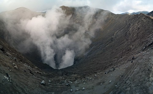 Look into the smoking crater of Mt. Bromo, Java, Indonesia