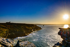 Late afternoon winter sun. (CAscotPhotography) Tags: cornwall tintagel kingarthur legend sun sunflare sea seascape cliff cliffs church ocean cascotphotography nikon d7100 landscape