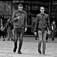 DSCN2198 (Akbar Simonse) Tags: holland netherlands nederland rotterdam streetphotography streetshot straatfotografie straatfoto peope men candid phone smartphone bw blancoynegro bn zwartwit monochrome vierkant squareformat akbarsimonse jeans jackets