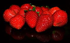The strawberries (kingshuk mukherjee) Tags: red fruits strawberries blackbackground stilllife