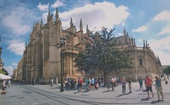 Catedral de Sevilla. (saul1494) Tags: city blue sky urban españa color building art apple monument architecture clouds landscape spring sevilla spain arquitectura colorful day view cathedral pano catedral landmark icon panoramic andalucia avenue panorámica vsco vscocam vscogrid