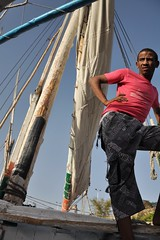 A short break (Thorsten Reiprich) Tags: africa city urban man travelling sunshine port evening spring harbour relaxing egypt heat worker assuan