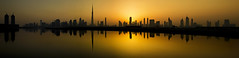 The Sunset Behind SZR (Almsaeed) Tags: road sunset panorama lake reflection water colors yellow canon dubai outdoor mark iii horizon towers uae eid emirates zayed khalifa level 5d curve burj tallest shiekh mubarak szr skyscarper