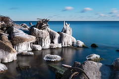 Icy Grip, Lake Ontario (Brian Krouskie) Tags: ice lake ontario toronto rocks rubble rebar junk winter outdoor landscape water sky clouds slate blue longexposure