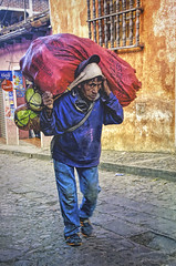 Going To Market 4 (Artypixall) Tags: guatemala chichicastenango man carrying bundle urbanscene street