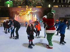 Violet And The Grinch On The Ice (Joe Shlabotnik) Tags: iceskating december2016 skating manhattan rockefellercenter statue prometheus 2016 newyorkcity grinch nyc violet fountain 60225mm