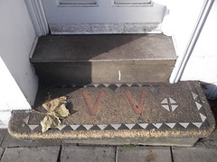 27th December 2016 (themostinept) Tags: letters vv step stair mosaic pattern doorway leaf oneleaf steps stairs pavement london islington essexroad n1 shadow light sunlight