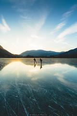 Sunset skating (Nicola Pezzoli) Tags: lago endine lake ice winter cold bergamo lombardia italy tourism colors monasterolo sunset skating glow