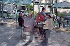 Domino Players (Eddie La Mole) Tags: plazaeugeniomaríadehostos oldsanjuan domino streetphotography film 35mm c41 color kodakektar minoltaxe7 rokkorx50mm14
