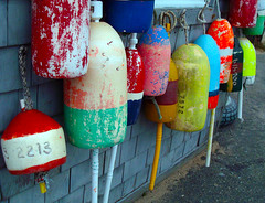 PTown Buoys (Jae at Wits End) Tags: ocean pink blue red sea orange white green yellow outside seaside fishing dock marine colorful exterior outdoor decay provincetown massachusetts newengland pale faded coastal shore maritime worn marker weathered nautical float multicolored buoys seashore ptown bleached buoy faint washedout discolored 2213 buoyant
