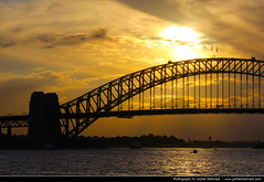 Sydney Harbour Bridge @ Sunset, Australia (JH_1982) Tags: new travel bridge sunset sky sun building travelling water colors yellow wales architecture clouds port canon eos evening harbor zonsondergang tramonto glow arch colours sonnenuntergang harbour steel south sydney australia landmark jackson prdosol nsw coathanger through australien traveling tamron ocaso  coucherdesoleil solnedgang australie bradfield 18mm apus solnedgng  auringonlasku      zachdsoca   270mm  matahariterbenam 60d      mttriln sdney