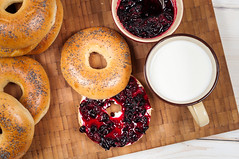 Fresh homemade Poppy bagels bread with cup of milk, cream cheese and berries jam (Dariia_Belkina) Tags: bagel bakery bread breakfast brunch bun butter carbs cereal cheese circle closeup crispy crust cup cut dairy diet dough drink fast golden grains grill group half health hole hot jam knife lunch milk organic pastry poppy round rustic seed soft stack sweet toasted top uneven view wheat whole wholesome wood