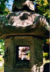 Japanese Garden (Jae at Wits End) Tags: sanfrancisco california light sculpture blur art window monument statue stone garden japanesegarden shadows dof bokeh depthoffield figure opening portal publicart shallowfield