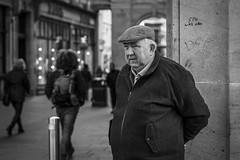 Stu Waz Ere (Leanne Boulton) Tags: people monochrome urban street candid portrait portraiture streetphotography candidstreetphotography candidportrait streetportrait streetlife old age aged elderly man male face facial expression look emotion feeling cap flatcap composition tone texture detail depthoffield bokeh natural outdoor light shade shadow city scene human life living humanity society culture canon 5d 5dmarkiii 70mm character ef2470mmf28liiusm black white blackwhite bw mono blackandwhite glasgow scotland uk