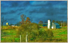 Waiting it out... (Sherrianne100) Tags: silo barn fence stormy storm ozarks missouri farm