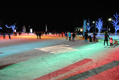 Colours on the ice (apta_2050) Tags: harbourfrontcentre natrelrink skatingrink skating colours lights reflections snow christmas christmaslights lighting harbourfront toronto ontario